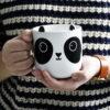 Cogiendo la taza panda Aiko
